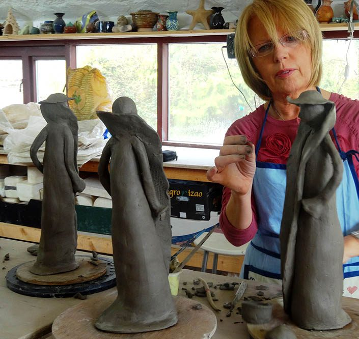 woman in adult pottery class