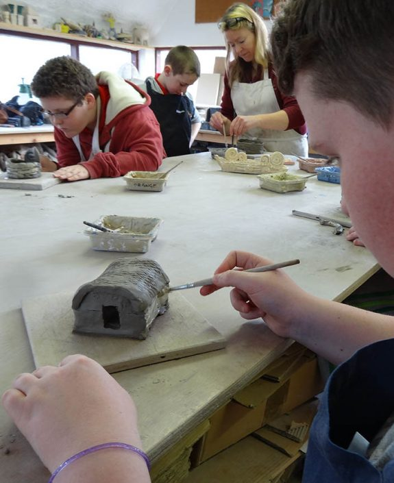 children painting pottery
