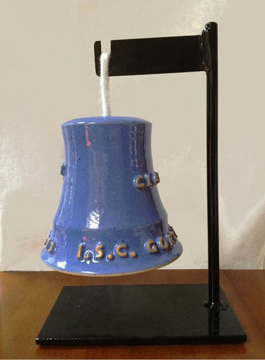 Ceramic bell on stand