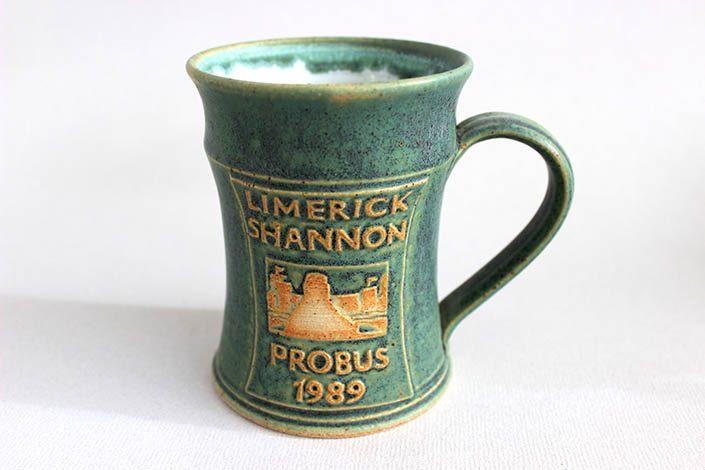 green pottery tankard